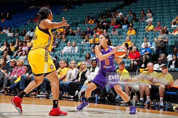 Marta Xargay Casademont of the Phoenix Mercury looks to pass the ball against the Tulsa Shock during Game Two of the WNBA Western Conference...