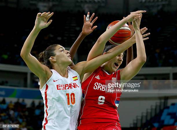 Marta Xargay of Spain and Jelena Milovanovic of Serbia fight for the rebound during the Women's Basketball Semifinal match at the Carioca Arena on...