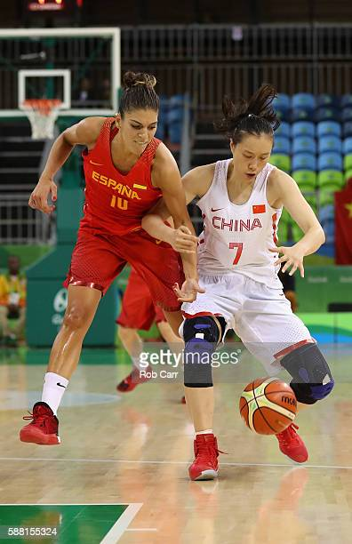Marta Xargay of Spain and Ting Shao of China go after the ball in the Women's Basketball Preliminary Round Group B match between China and Spain on...