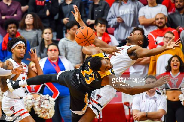 Martaveous McKnight of the ArkansasPine Bluff Golden Lions is called for an offensive foul against Malik Ondigo of the Texas Tech Red Raiders during...