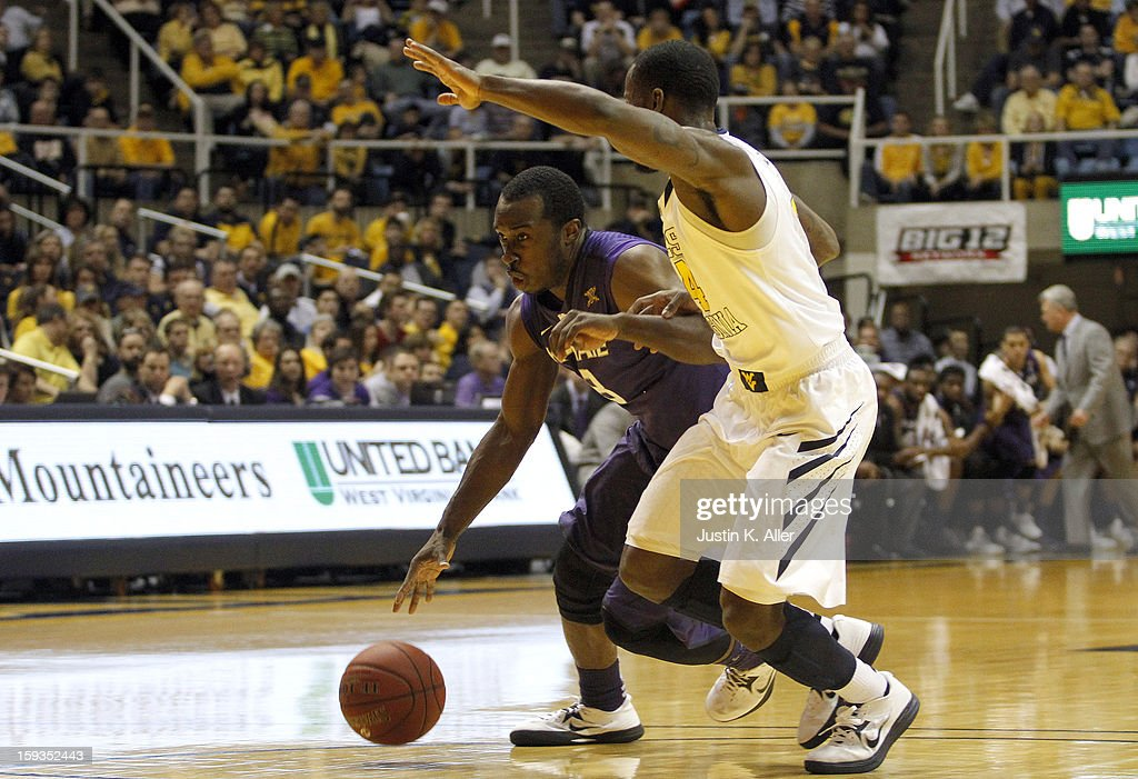 Martavious Irving #3 of the Kansas State Wildcats drives to the basket against the West Virginia Mountaineers during the game at at the WVU Coliseum on January 12, 2013 in Morgantown, West Virginia.