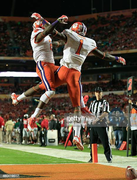 Martavis Bryant and Sammy Watkins of the Clemson Tigers celebrate after a touchdown by Bryant in the second quarter against the Ohio State Buckeyes...