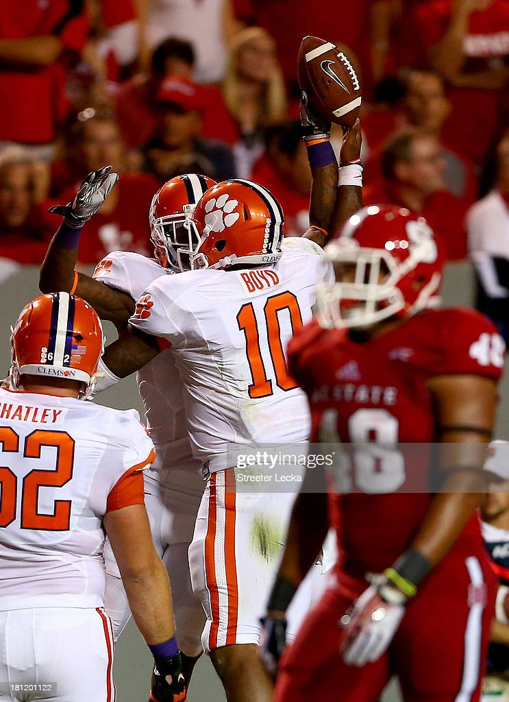 Martavis Bryant #1 of the Clemson Tigers celebrates with teammate Tajh Boyd after a touchdown against the North Carolina State Wolfpack during their game at Carter-Finley Stadium on September 19, 2013 in Raleigh, North Carolina.