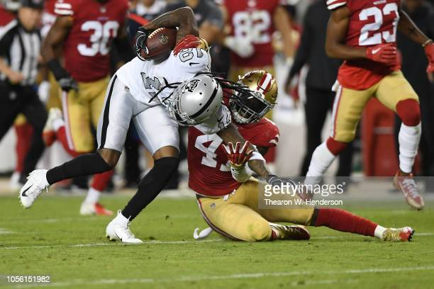 Martavis Bryant of the Oakland Raiders is tackled by Elijah Lee of the San Francisco 49ers during their NFL game at Levi's Stadium on November 1,...