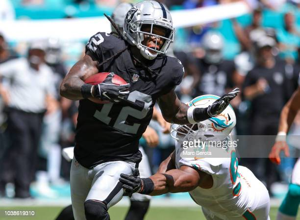 Martavis Bryant of the Oakland Raiders runs for yardage during the second quarter against the Miami Dolphins at Hard Rock Stadium on September 23,...