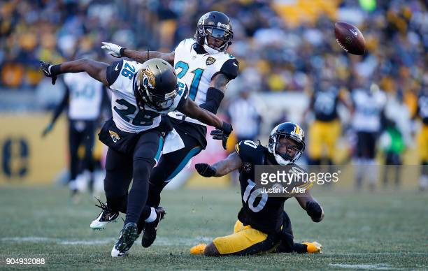 Martavis Bryant of the Pittsburgh Steelers cannot come up with a catch while being defended by Jarrod Wilson of the Jacksonville Jaguars and AJ Bouye...