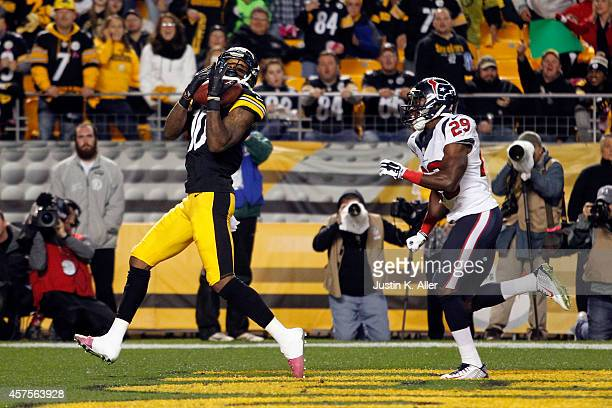 Martavis Bryant of the Pittsburgh Steelers catches a 35 yards touchdown pass in the second quarter against Andre Hal of the Houston Texans during...