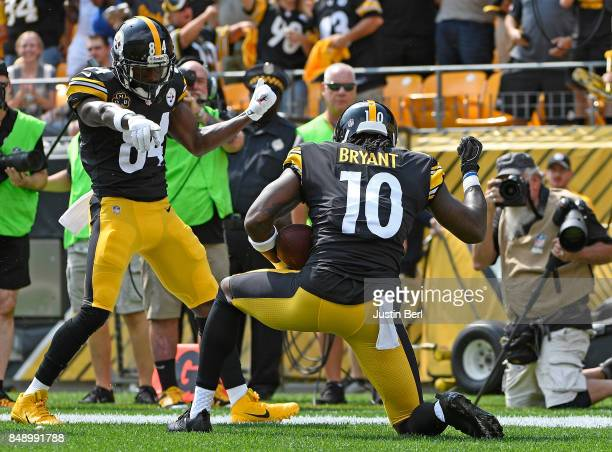 Martavis Bryant of the Pittsburgh Steelers celebrates with Antonio Brown after a 27yard touchdown reception in the first quarter during the game...