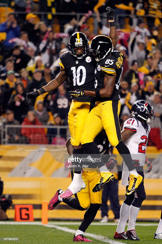 Martavis Bryant #10 of the Pittsburgh Steelers celebrates with Darrius Heyward-Bey #85 after catching a 35 yards touchdown pass in the second quarter against Andre Hal #29 of the Houston Texans during their game at Heinz Field on October 20, 2014 in Pittsburgh, Pennsylvania.