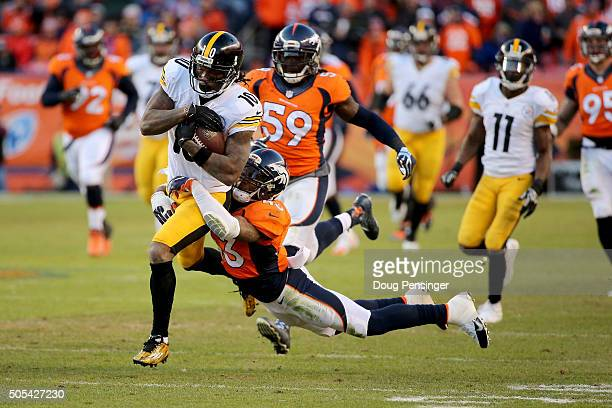 Martavis Bryant of the Pittsburgh Steelers is tackled by TJ Ward of the Denver Broncos during the AFC Divisional Playoff Game at Sports Authority...
