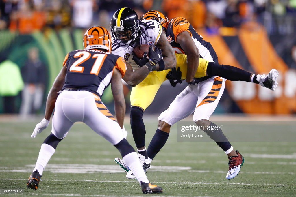 Martavis Bryant #10 of the Pittsburgh Steelers is tackled by William Jackson #22 and Darqueze Dennard #21 of the Cincinnati Bengals during the first half at Paul Brown Stadium on December 4, 2017 in Cincinnati, Ohio.