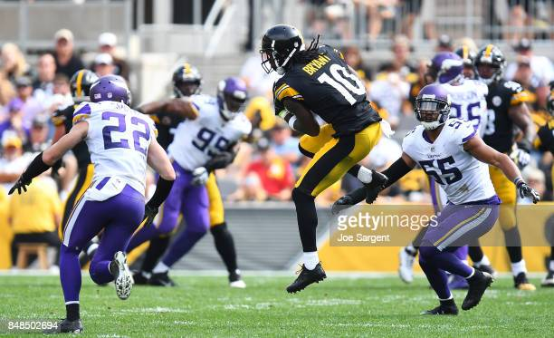 Martavis Bryant of the Pittsburgh Steelers makes a catch between two Minnesota Vikings defenders in the second half during the game at Heinz Field on...