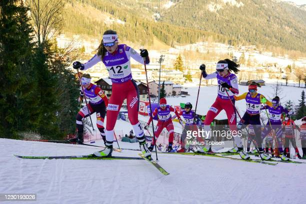Marte Leinan Lund of Norway, Mari Leinen Lund of Norway and Jenny Nowak of Germany competes during the Women's Gundersen Normal Hill HS98/5.0 Km at...