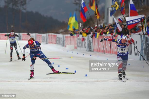 Marte Olsbu of Norway and Gabriela Koukalova of Czech Republic cross the finish line during the women's 4x6 km relay event of the Biathlon World Cup...