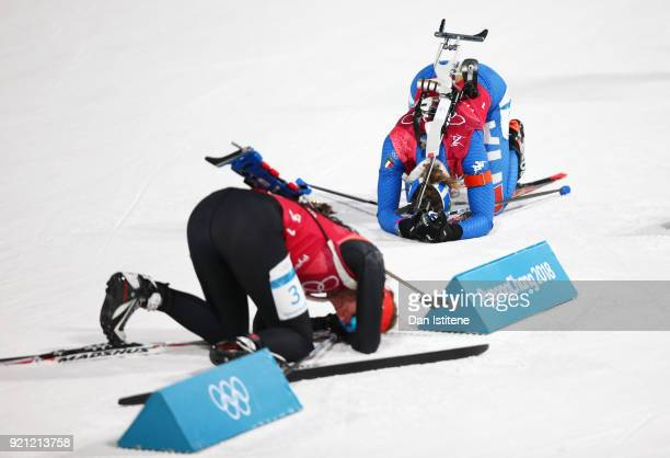 Marte Olsbu of Norway and Lisa Vittozzi of Italy collapse after completing the first leg during the Biathlon 2x6km Women 2x75km Men Mixed Relay on...