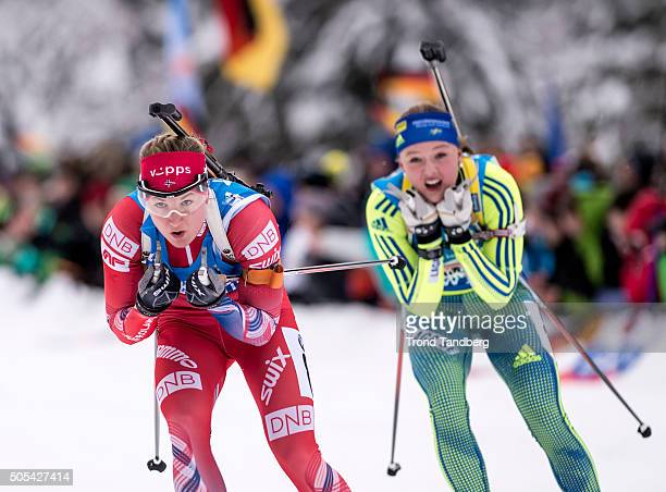 Marte Olsbu of Norway Linn Persson of Sweden in action during the Women 4 x 5 km relay Biathlon race at the IBU Biathlon World Cup Ruhpolding on...