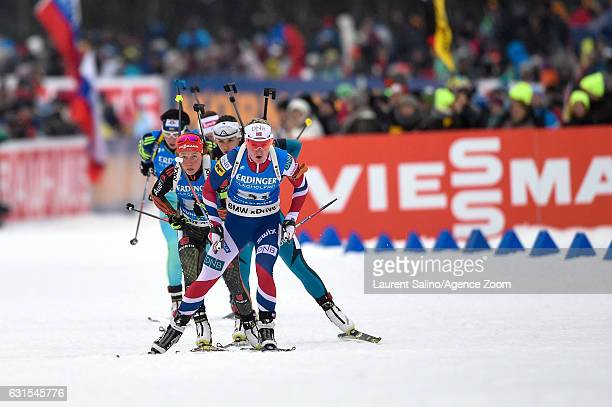 Marte Olsbu of Norway takes 3rd place, Laura Dahlmeier of Germany takes 1st place, Celia Aymonier of France takes 2nd place during the IBU Biathlon...