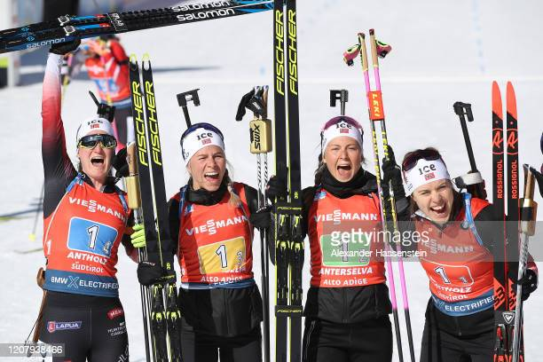 Marte Olsbu Reiseland of Norway and team mates Tiril Eckhoff, Ingrid Landmark Tandrevold and Synnoeve Solmedal celebrate winning the 1st place after...