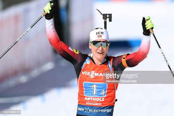 Marte Olsbu Roeiseland of Norway celebrate winning the 1st place as she crossed the finish line of the Women 4x6 km Relay Competition at the IBU...