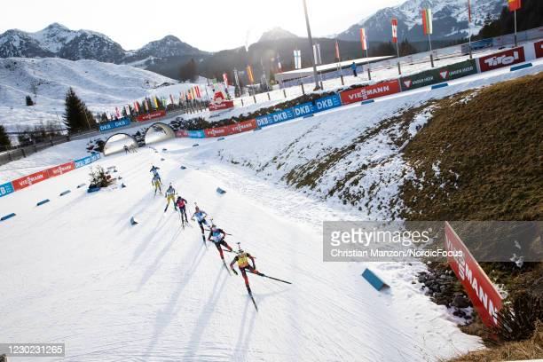Marte Olsbu Roeiseland of Norway, Tiril Eckhoff of Norway and Clare Egan of the United States of America lead the field into the stadium after the...