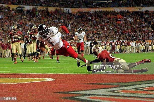 Martel Moore of the Northern Illinois Huskies scores an 11yard touchdown reception in the third quarter against Lamarcus Joyner of the Florida State...