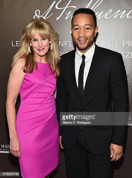 J Martell CEO Laure Heatherly and recording artist John Legend attend the TJ Martell Foundation's Women Of Influence Los Angeles Event at the Loews...