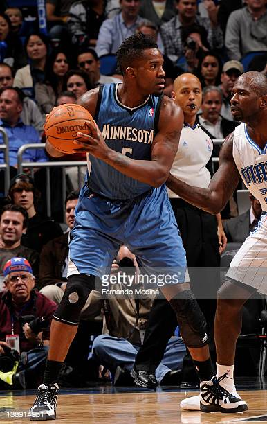 Martell Webster of the Minnesota Timberwolves drives to the basket against Jason Richardson of the Orlando Magic during the game on February 13 2012...