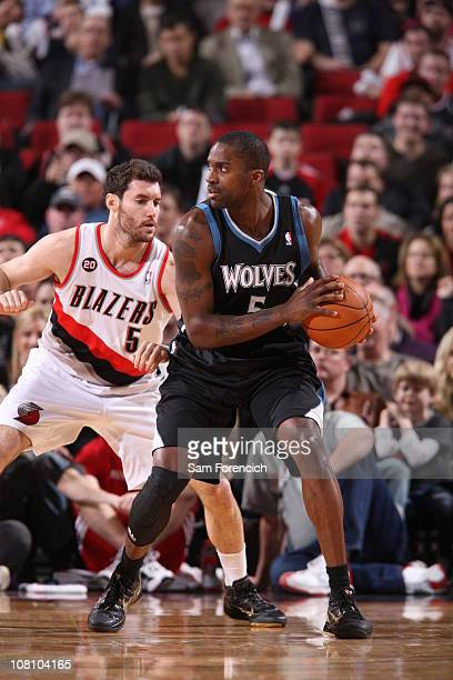 Martell Webster of the Minnesota Timberwolves looks for an opening around Rudy Fernandez of the Portland Trail Blazers during a game on January 17...