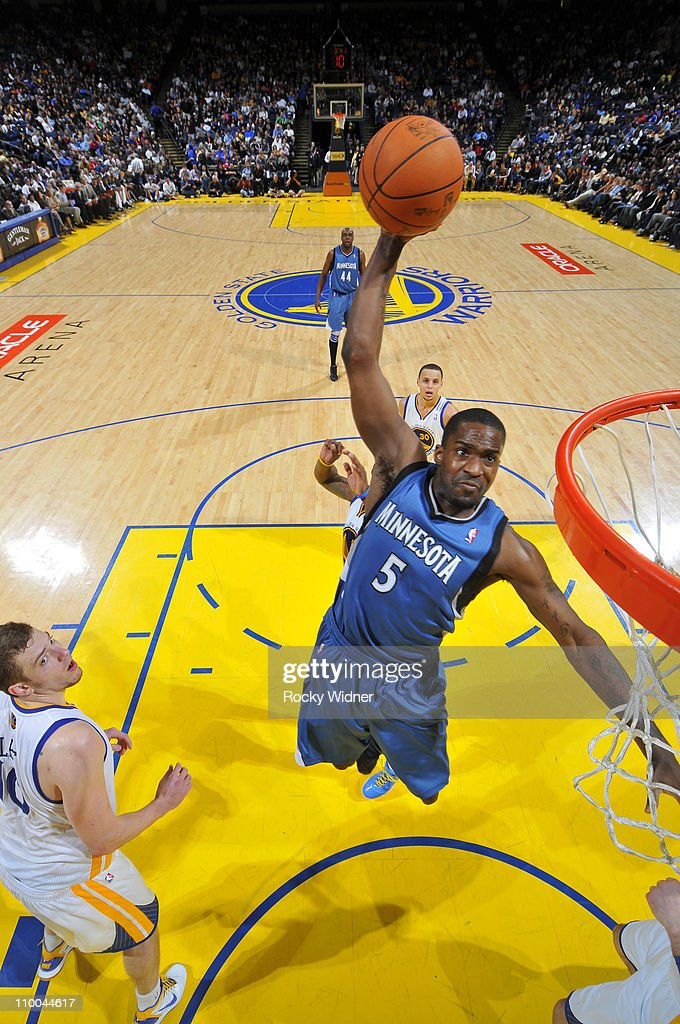 Martell Webster #5 of the Minnesota Timberwolves soars through the air for a dunk against David Lee #10 of the Golden State Warriors on March 13, 2011 at Oracle Arena in Oakland, California.