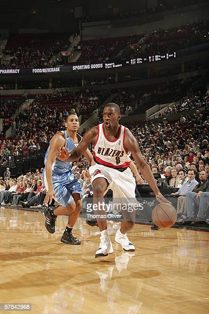 Martell Webster of the Portland Trail Blazers dribbles against Howard Eisley of the Denver Nuggets at the Rose Garden on April 10 2006 in Portland...