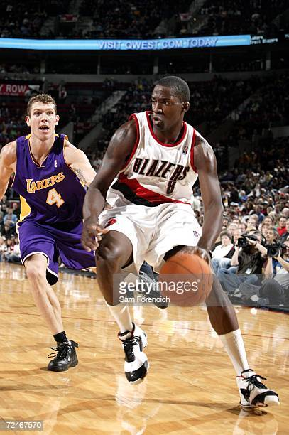 Martell Webster of the Portland Trail Blazers drives past Luke Walton of the Los Angeles Lakers during a game on November 8 2006 at the Rose Garden...