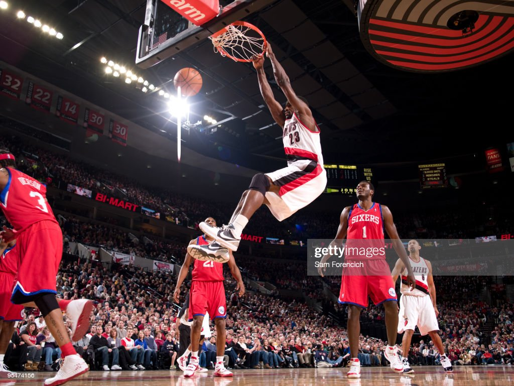 Martell Webster #23 of the Portland Trail Blazers dunks past Samuel Dalembert #1 of the Philadelphia 76ers during a game on December 28, 2009 at the Rose Garden Arena in Portland, Oregon.