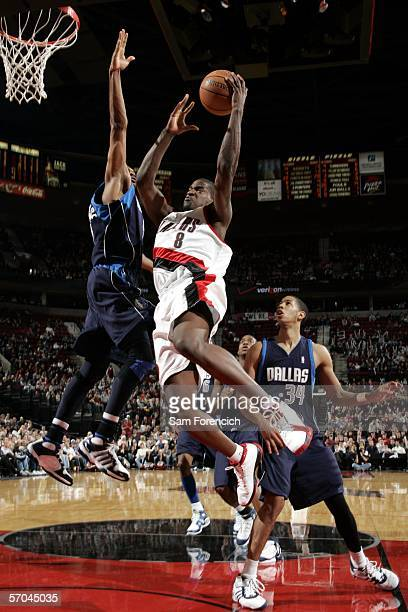 Martell Webster of the Portland Trail Blazers goes for a shot agienst Jerry Stackhouse of the Dallas Mavericks during a game on March 9 2006 at the...