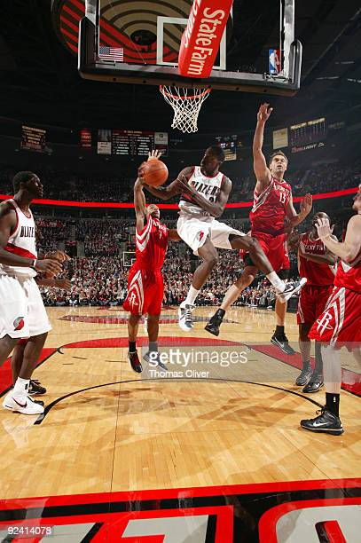 Martell Webster of the Portland Trail Blazers goes up for a shot past David Andersen of the Houston Rockets during the season opening game on October...