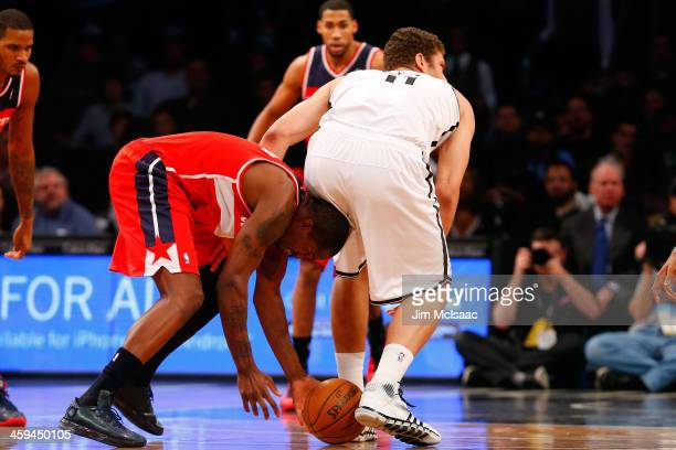 Martell Webster of the Washington Wizards in action against Brook Lopez of the Brooklyn Nets at Barclays Center on December 18 2013 in the Brooklyn...