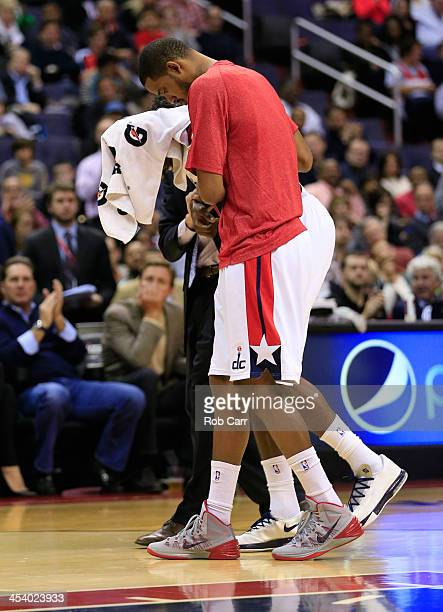 Martell Webster of the Washington Wizards is helped off the floor after being injured during the first quarter against the Milwaukee Bucks at Verizon...