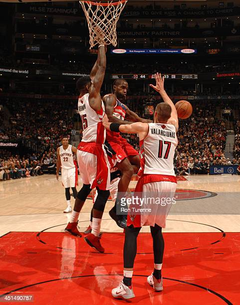 Martell Webster of the Washington Wizards passes the ball against Jonas Valanciunas of the Toronto Raptors on November 22 2013 at the Air Canada...