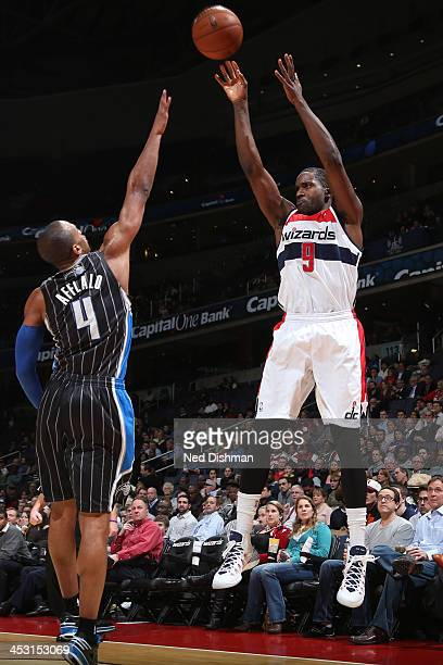 Martell Webster of the Washington Wizards shoots against Arron Afflalo of the Orlando Magic during the game at the Verizon Center on December 2 2013...