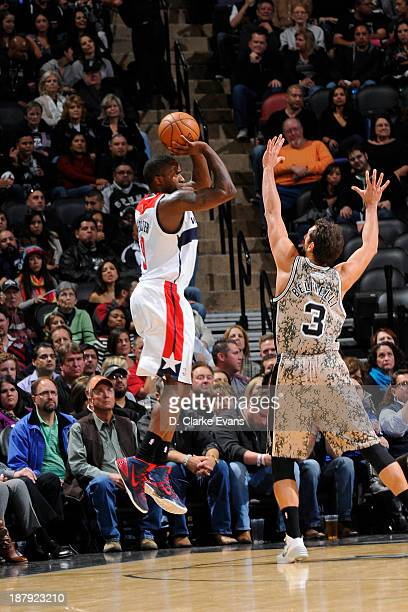 Martell Webster of the Washington Wizards shoots against Marco Belinelli of the San Antonio Spurs at the ATT Center on November 13 2013 in San...