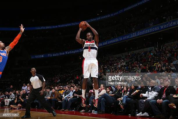 Martell Webster of the Washington Wizards shoots the ball against the New York Knicks during the game at the Verizon Center on November 23 2013 in...