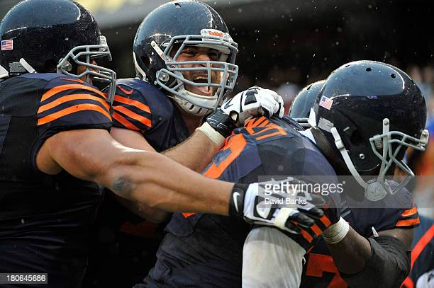 Martellus Bennett of the Chicago Bears is greeted by Kyle Long after catching the game winning touchdown against the Minnesota Vikings on September...