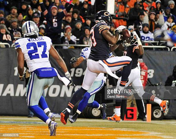 Martellus Bennett of the Chicago Bears makes a touchdown catch between JJ Wilcox of the Dallas Cowboys and Brandon Carr of the Dallas Cowboys during...