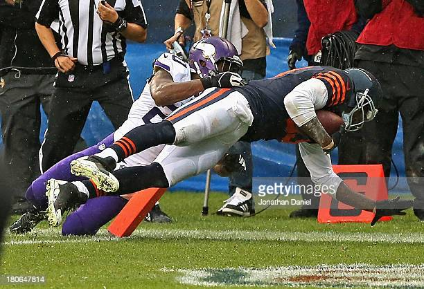 Martellus Bennett of the Chicago Bears scores the gamewinning touchdown over Chris Cook of the Minnesota Vikings with 10 seconds left in the game at...