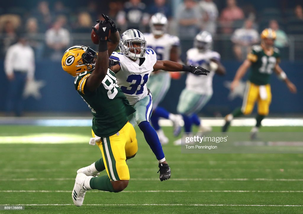 Martellus Bennett #80 of the Green Bay Packers catches a pass as Byron Jones #31 of the Dallas Cowboys defends in the third quarter of a football game at AT&T Stadium on October 8, 2017 in Arlington, Texas.