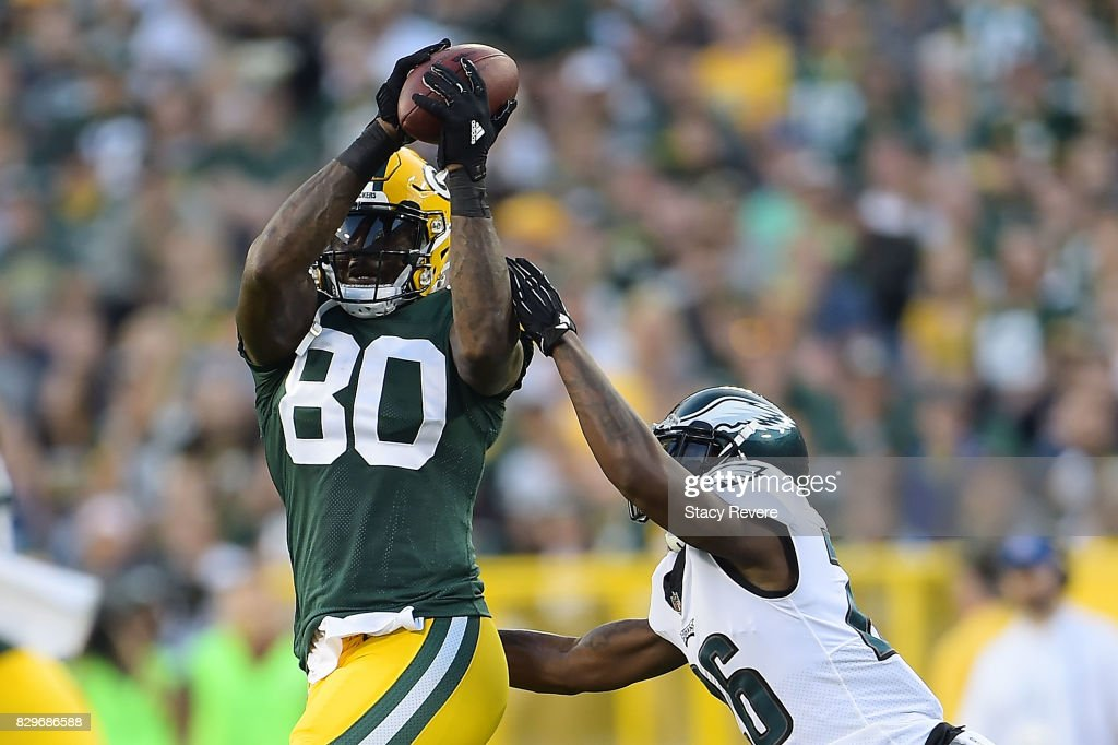 Martellus Bennett #80 of the Green Bay Packers catches a pass in front of Jaylen Watkins #26 of the Philadelphia Eagles during the second quarter of a preseason game at Lambeau Field on August 10, 2017 in Green Bay, Wisconsin.