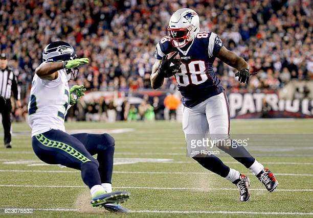 Martellus Bennett of the New England Patriots carries the ball after making a catch during the second quarter of a game against the Seattle Seahawks...