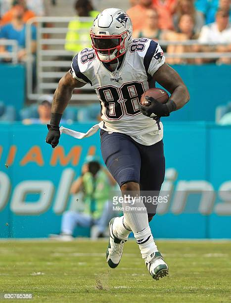 Martellus Bennett of the New England Patriots makes a catch during a game against the Miami Dolphins at Hard Rock Stadium on January 1 2017 in Miami...