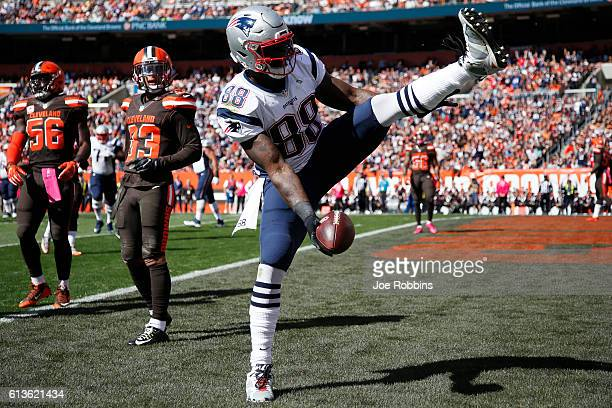 Martellus Bennett of the New England Patriots reacts after a sevenyard touchdown reception in the first quarter of the game against the Cleveland...