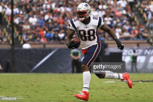 Martellus Bennett of the New England Patriots runs with the ball after a reception against the Oakland Raiders during the second half at Estadio...