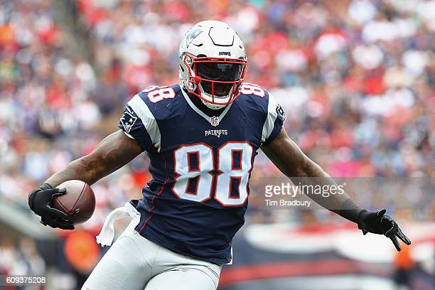 Martellus Bennett of the New England Patriots runs with the ball during the first half against the Miami Dolphins at Gillette Stadium on September 18...